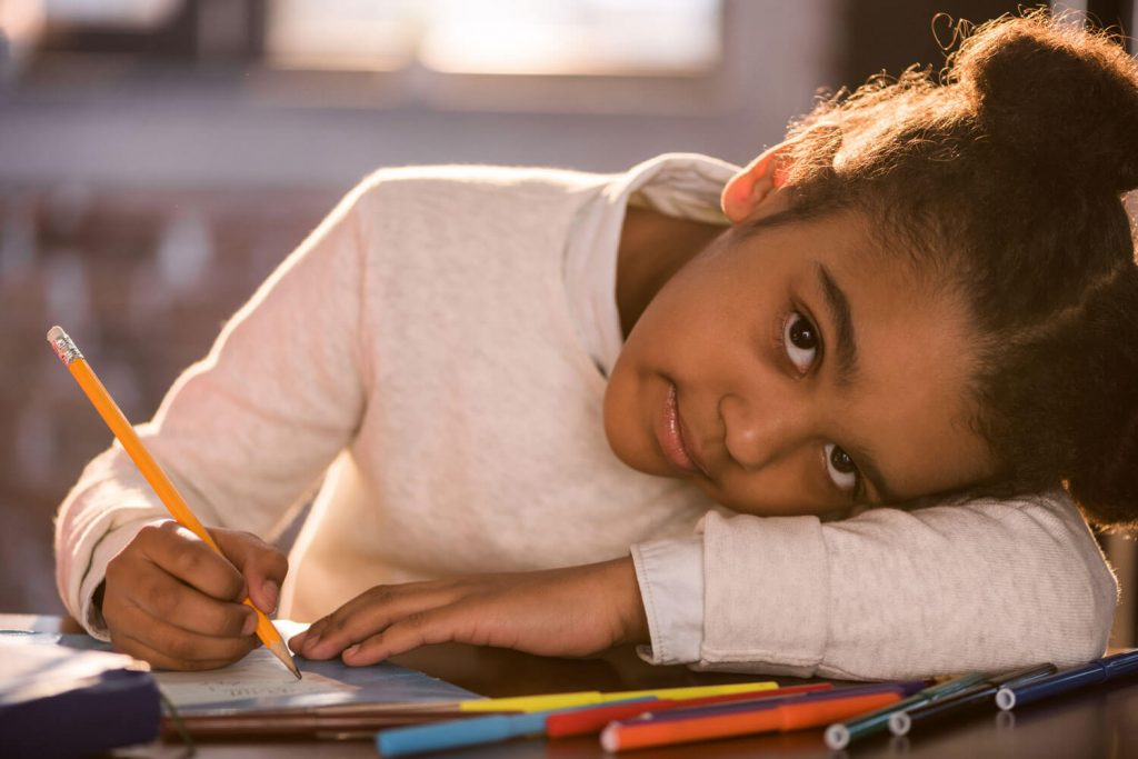 News for foster carers: young girl colouring at table
